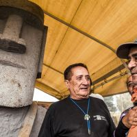 Making an offering: Easter Islanders stand in front of a Moai statue they were working on at the end of July. The statue will be sent to Minamisanriku, Miyagi Prefecture, which was devastated by the earthquake and tsunami in March 2011. | KYODO