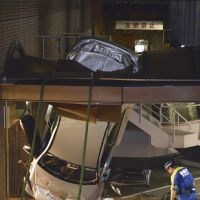 Head-in parking: A car stands on its front end Sunday night after plunging off the parking garage at the Imperial Hotel in Chiyoda Ward, Tokyo. | KYODO
