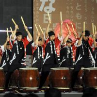 The beat goes on: High school students from Fukushima Prefecture play traditional Japanese drums during a cultural exchange event in Seoul on  Wednesday. | KYODO
