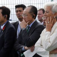 True story: Last year's quake-tsunami disaster is recounted Wednesday to (from right) International Monetary Fund chief Christine Lagarde,  World Bank President Jim  Yong Kim and Finance Minister Koriki Jojima by  Takao Kawamura, director of Sendai's Arahama Elementary School. | AP