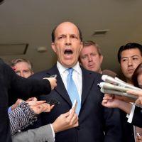 Damage control: U.S. Ambassador John Roos faces reporters as he delivers a statement after meeting Friday with Vice Foreign Minister Shuji Kira at the Foreign Ministry. | AFP-JIJI