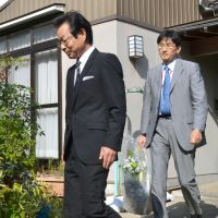 Apology unaccepted: Schindler Elevator director Michiaki Otsuki (left) leaves the home of Toshiko Maeda, who was crushed to death this week by one of the firm's elevators, after apologizing to her family Friday in Nomi, Ishikawa Prefecture. | KYODO