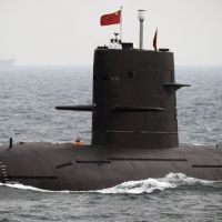 Silent service?: A Chinese submarine takes part in an international fleet review to celebrate the 60th anniversary of the founding of the People's Liberation Army Navy in Qingdao, Shandong Province, in April 2009. | REUTERS/KYODO