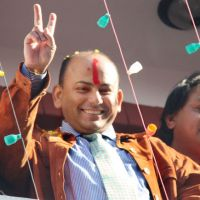 Cleared: Govinda Prasad Mainali, who was exonerated of murder  Wednesday by a  Tokyo court, flashes a victory sign to supporters at his home in Katmandu. | KYODO