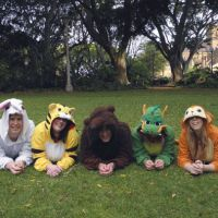 They just pelt like it: Friends (from left) Laurence Bye, Sarah Dale, Patrick Westhoff, Siobhan Stewart and Claire Delohery wear animal onesies in Sydney's Hyde Park recently. | JIJI