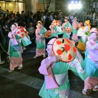 Traditional Yamagata Prefecture dances are performed Oct. 13 to entertain participants of the IMF event in the Marunouchi district. | KYODO