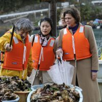 Ah shucks: German farm minister Ilse Aigner visits an oyster farm in Kesennuma, Miyagi Prefecture, on Monday. | KYODO