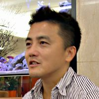 Alleviating hunger: Masa Kogure, director of Table for Two International, is interviewed in London on Oct. 23. | KYODO