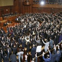Battle cry: Lawmakers from the opposition and ruling camps let out a traditional banzai cry as Lower House Speaker Takahiro Yokomichi announces the chamber's dissolution Friday, setting the Dec. 16 general election in motion. | KYODO