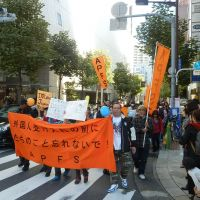 Staying power: Foreign residents who have overstayed their visas call on the government to grant them special residency permits at a rally Sunday in Tokyo's Ginza district. | SETSUKO KAMIYA