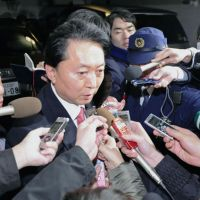 Moving on: Reporters swarm ex-Prime Minister Yukio Hatoyama at his Tokyo home early Wednesday. | KYODO