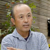 The long run: Marathon commentator Tetsuhiko Kin speaks in Tokyo on Oct. 15. | KYODO