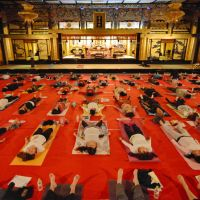 Physical, mental, spiritual: Young women practice yoga in the Main Hall of Hongan-ji Nagoya Betsuin. The 'Temple Yoga' class was recently started to attract young women to the temple. | CHUNICHI SHIMBUN