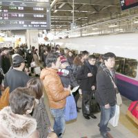 Fully booked: People line up to board a bullet train Thursday at JR Sendai Station. | KYODO