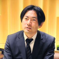 Playing catchup: Yasuyuki Watanabe, deputy mayor of Nasushiobara, Tochigi Prefecture, speaks during an interview at a Tokyo hotel on Dec. 11. | SATOKO KAWASAKI