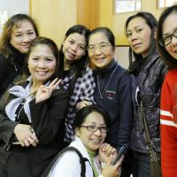 Helping others: Yukie Nogami (third from right), a sister of the Institute of the Handmaids of the Sacred Heart of Jesus, is seen at a social event following Mass in Ofunato, Iwate Prefecture, last November. With her is Gina Konishi (third from left) and her friends. | KYODO