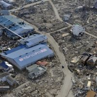 A photo from April 1, 2011, shows a frozen food factory surrounded by tsunami debris in the town of Ishinomaki, Miyagi Prefecture. | AFP-JIJI