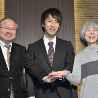 Literati glitterati: Naoki Prize winners Ryutaro Abe (left) and Ryo Asai (center), along with Akutagawa Prize winner Natsuko Kuroda, attend a news conference after being named recipients of the literary awards Wednesday evening. | KYODO