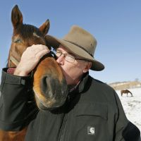 Horse whisperer: Harry Sweeney kisses Love And Bubbles, mare of Japanese Derby winner Deep Brillante, at his Paca Paca Farm in Hidaka, Hokkaido, on Nov. 28. | KYODO