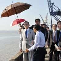 Point man: Taro Aso inspects a port near Yangon on Jan. 4. | KYODO