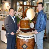 Drumroll please: Akitoshi Asano (left) and Katsuji Asano, of Asano Taiko Co., are seen with a 'taiko' drum at the firm's office in Hakusan, Ishikawa Prefecture, in December. | KYODO