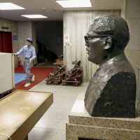 NEXT STOP OR BUSTIllustrious onlooker: A bust of Inejiro Asanuma, the former chief of the Japan Socialist Party who was assassinated in 1960, sits inside the headquarters of the Social Democratic Party in Tokyo's Nagata-cho district Saturday as work began to move out of the historic building. | KYODO