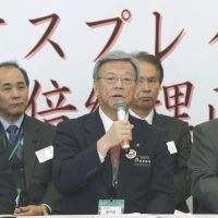 Osprey hunt: Naha Mayor Takeshi Onaga faces reporters Monday in Tokyo after handing in a petition against the deployment of MV-22s in Okinawa to Prime Minister Shinzo Abe. | KYODO