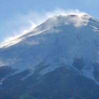 Under the volcano: White wisps swirl around Mount Fuji as seen from Fujiyoshida, Yamanashi Prefecture, on Jan. 18. | KYODO