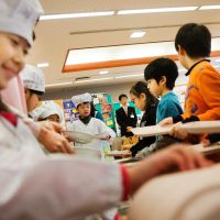 No junk food here: Third-graders serve lunch to their classmates Jan. 16 at Umejima Elementary School in Adachi Ward, Tokyo. | THE WASHINGTON POST