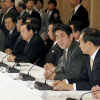 Prime Minister Shinzo Abe speaks at a meeting on a package of economic stimulus measures | KYODO