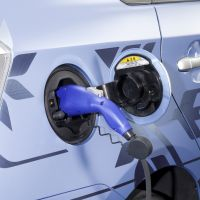 An electric car has its battery charged. | TOYOTA MOTOR CORP.