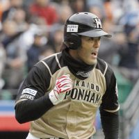 Closing in on 2,000: Hokkaido Nippon Ham's Atsunori Inaba heads for first base on an RBI single in the ninth inning against Chiba Lotte on Saturday at QVC Marine Field. | KYODO