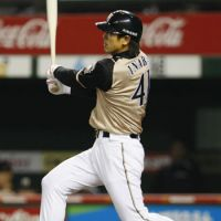 Unlucky for some: Atsunori Inaba hits a two-run home run in the eighth inning of the Fighters' 13-0 rout of the Lions on Monday. | KYODO