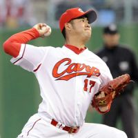 Solid outing: Carp hurler Kan Otake holds the BayStars to four hits in seven scoreless innings on Tuesday. Hiroshima defeated Yokohama 3-0. | KYODO