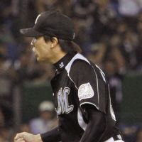 Big lift: Marines reliever Naoya Masuda worked out of a bases-loaded jam in the eighth inning against the Fighters on Tuesday at Tokyo Dome. Chiba Lotte defeated Hokkaido Nippon Ham 2-1. | KYODO