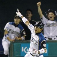 See you later: Nippon Ham's Atsunori Inaba celebrates his home run against Lotte on Thursday at Tokyo Dome. The Fighters won 2-1. | KYODO