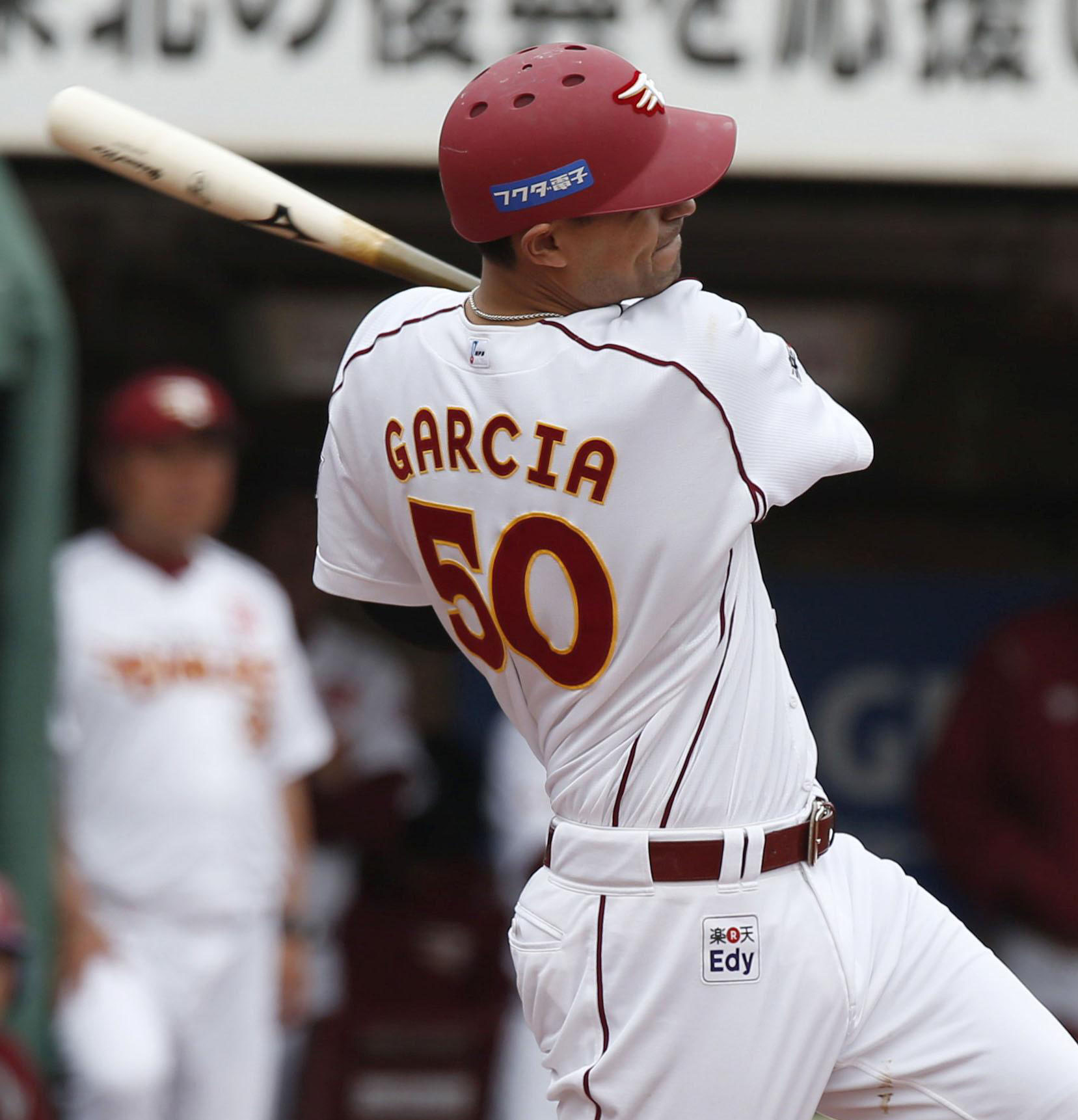 There it goes: The Eagles' Luis Garcia hits a solo homer in the seventh inning on Monday. | KYODO