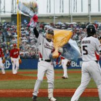 Let it sink in: Swallows infielder Shinya Miyamoto celebrates after his 2,000th career hit during Yakult's 8-4 win over Hiroshima on Friday. | KYODO