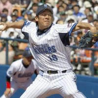 Going the distance: Yokohama starter Daisuke Miura fires a pitch against Chunichi on Saturday. The BayStars routed the Dragons 12-1. | KYODO