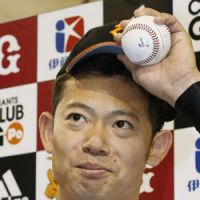 Getting the job done: Giants reliever Masumi Hoshino picked up his first career win on Sunday, pitching three scoreless innings against the Fighters. Yomiuri defeated Hokkaido Nippon Ham 2-1 at Tokyo Dome. | KYODO