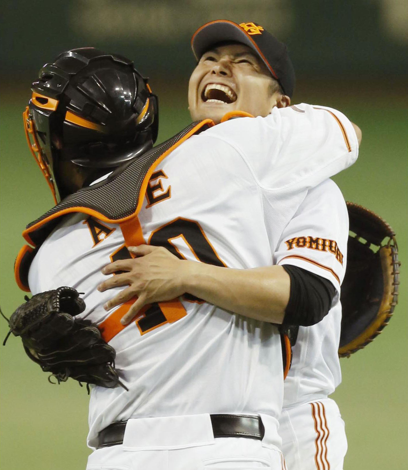 Almost perfect: Giants pitcher Toshiya Sugiuchi celebrates with catcher Shinnosuke Abe after throwing a no-hitter against the Golden Eagles on Wednesday. | KYODO