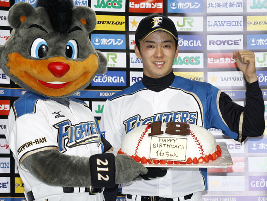 It's a celebration: Fighters pitcher Yuki Saito receives a birthday cake after his win over the Carp. Saito, who turned 24 on Wednesday, won for the first time since 4. | KYODO