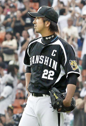 Nobody loses: Closer Kyuji Fujikawa and his Hanshin Tigers teammates had to settle for a 6-6 tie against the Chiba Lotte Marines on Sunday in interleague play. | KYODO