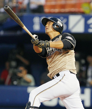 No doubt about it: Fighters slugger Sho Nakata belts a third-inning home run against the BayStars on Monday at Yokohama Stadium. Hokkaido Nippon Ham defeated Yokohama 7-3. | KYODO
