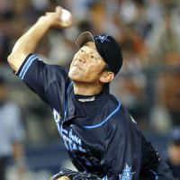 Long time coming: BayStars starter Daisuke Miura pitches against the Giants on Wednesday in Yokohama. Miura won to earn his 150th career victory. | KYODO