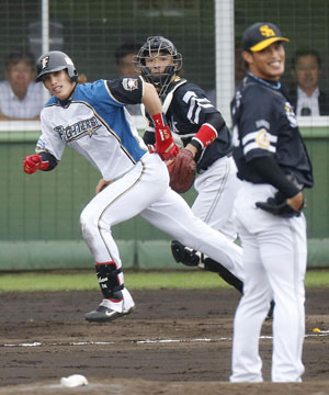 All out: Fighters outfielder Daikan Yoh singles against the Hawks during the seventh inning on Wednesday. The Fighters won 7-6. | KYODO