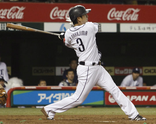 Unleashed: Seibu's Hiroyuki Nakajima hits a three-run double during the fourth inning on Friday. | KYODO