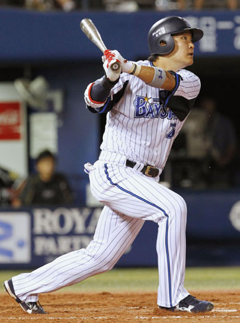 Long gone: Yokohama slugger Yoshitomo Tsutsugo homers against the Hanshin in the fifth inning on Wednesday night in Yokohama. The BayStars beat the Tigers 11-5. | KYODO