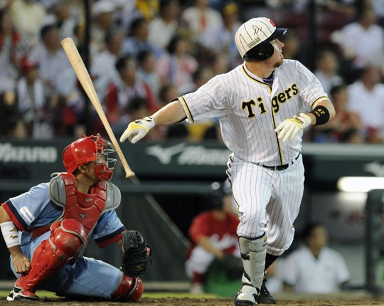 One last look: Hanshin's Craig Brazell watches the ball after hitting a three-run home run in the fourth inning of the Tigers' 3-2 win over the Carp on Sunday. | KYODO