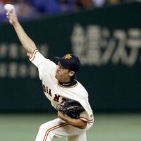 Solid outing: Giants hurler Yuki Koyama delivers a pitch against the BayStars on Friday at Tokyo Dome. Koyama held Yokohama to three hits in seven innings as Yomiuri defeated its Central League rival 2-1. | KYODO